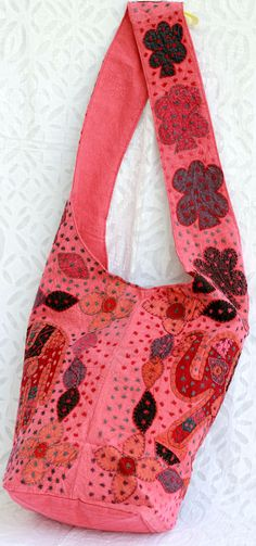 Beautiful blend of patch and thread work Jhola or shoulder fabric bag