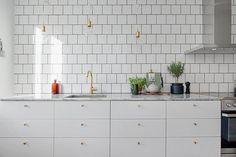 Cool grey and brass in a Gothenburg home