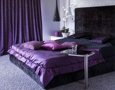 Luxury bedroom with purple accessories