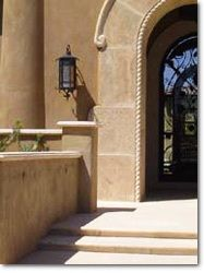 Cantera paved entryway in sand.
