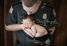newborn baby with dad police officer, newborn in police hat (could do the same for fireman)