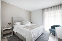 A minimalist master bedroom in the Chelsea neighborhood of Manhattan.