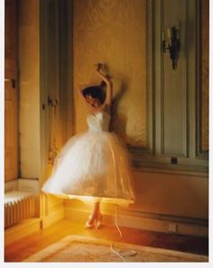 "I'm calling this ""Lady Lamp""  another camera shake/ motion blur shot by Tim Walker."