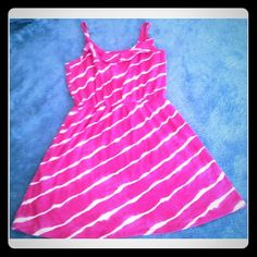 Cute Pink & White Cotton Sundress This is a cute summer dress. New w/o tags, in perfect condition. It's approximately knee length, with adjustable straps and a ruffle at the neckline. Faded Glory Dresses