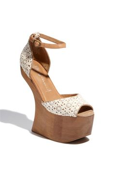 If i could just walk for a second in a pair of Jeffery Campbell heel-less platforms, i would die happy.