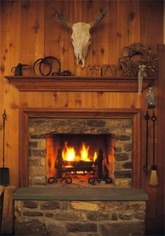 Kari:  I LOVE the extra 'mantle' above the fireplace - wouldn't that look nice in your new house?