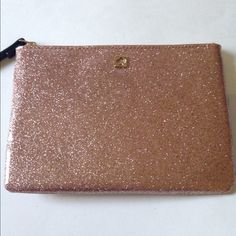 NWT Kate Spade Rose Gold Glitter Mini Pouch NWT Kate Spade Rose Gold Glitter Mini pouch. Perfectly glittery in the beautiful rose gold color that is so popular right now. Make this mini pouch hold whatever needs sparkle in your life.  No trades kate spade Bags Mini Bags