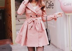 pink trench coat with a bow.