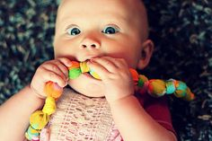 DIY teething necklace ~ a tutorial on how to make Mom a necklace out of vintage sheets for her teething baby to chew on