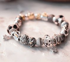 PANDORA Bracelet with Great Mix of Black, White and Silver Charms and a Hint of Gold♡