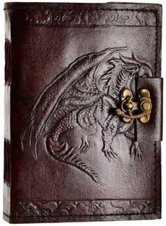 "Hand tooled blank leather journal with embossed winged dragon. Border embossing may vary. Sizes vary slightly. Leather, handmade paper. 240 pages, latch closure. 5"" x 7"""