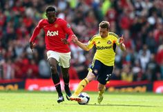 Emanuele Giaccherini of Sunderland is challenged by Danny Welbeck