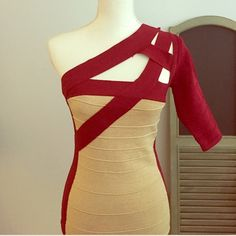 One-Sleeved Sexy Bandage Cocktail Dress Gorgeous one-sleeved / one-shoulder bandage dress, worn only once. Sad to see this dress go! Red/ burgundy trim on the sides and the chest and sleeve. The front and back is gold and glittery and glamorous!  Dress length is at the knee. Best suited for your curves and shapes to your body!  WOW couture Dresses One Shoulder
