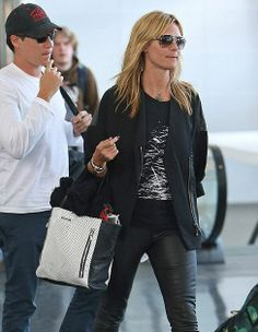 Heidi Klum breezes through JFK carrying the Elizabeth and James crackled, perforated James Tote.