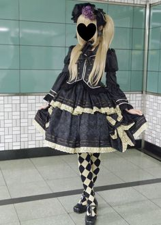 I usually don't like Gothic Lolita, but this one just really speaks to me. I guess I like the purple rose in her bonnet.