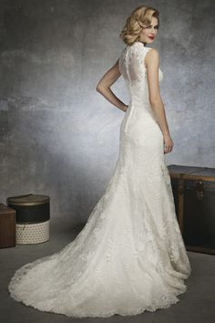 Queen Anne Venice lace and organza mermaid gown. High illusion back with buttons as the closure, and buttons to cover the back zipper. Style has a chapel length train.