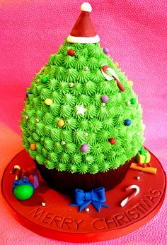 Giant cupcake Christmas tree cake.  (if it's a giant cupcake, then shouldn't it be called, ummm... a CAKE?)