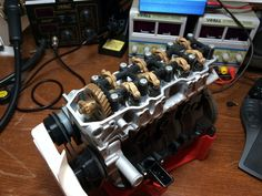 Entire Working Toyota 4 Cylinder Engine 3D Printed http://3dprint.com/39614/toyota-4-cylinder-engine-22re/