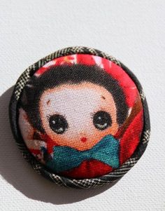 Fans of Blythe dolls may appreciate this quirky little number. Hand-crafted, Japanese fabric brooch with a wide-eyed d