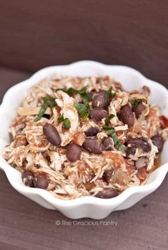 1 (about 7 ounces) boneless, skinless chicken breast 1 tbsp. garlic powder 1 tbsp. onion powder 1 tbsp. ground cumin 1/2 small red onion, chopped 1 (15 oz.) can or home-cooked black beans, drained and rinsed 1 (14.5 oz.) can diced tomatoes OR fresh, chopped tomatoes Salt to taste after cooking