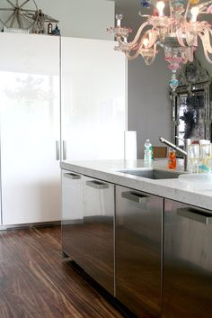 Fridge freezer white marble and beautiful floor.