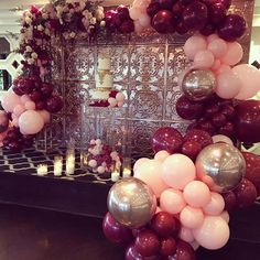 Baby Pink, Burgundy and Rose gold balloons with floral arrangement, perfect for a Christening