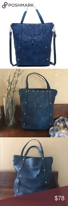 🎉HOST PICK 7/22🎉 Studded Maude tote in Blue This roomie tote will carry all of your necessities in style.  Featuring dual handle, a detachable crossbody strap and One zip closure pocket and two slide pockets on the interior.  There is one flap closure pocket on the outside. This is zip closure, vegan leather exterior and fabric lined interior. ❌ trades ✅ same day or next day shipping  13 L x 14.5 H x6 D Pink Haley Bags Totes
