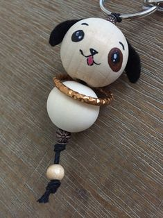 Wooden beads Doggy keychain, with metal insert and metal ring Bead Crafts, Diy Home Crafts, Crafts For Kids, Arts And Crafts, Mobiles, Halloween Bags, Polymer Clay Necklace, Bottle Crafts, Wooden Diy