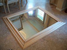DIY mirror frame using trim. Good idea for a plain mirror