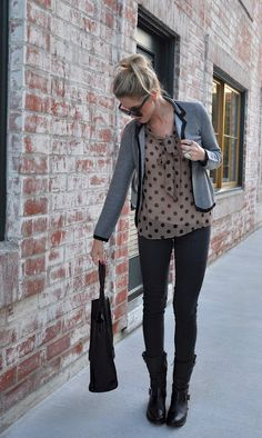 Polka-dot chiffon top, grey blazer, black skinnies, and black biker boots.