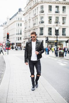 London street style look with distressed denim, worn in leather jacket and that white tee