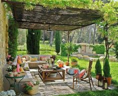 I'd want this for my backyard, just add in an outdoor fireplace or a small fire pit in the center. I love the idea of growing vines on top of the covering.