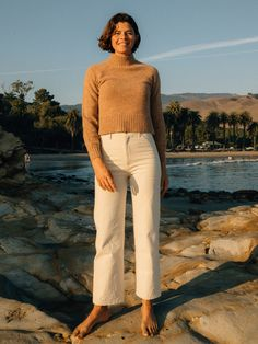 Soft and warm, the Jeanie Pullover is a fitted turtleneck sweater made of a flecked yarn with chunky rib hem. 65% Merino Wool, 30% Nylon, 5% Alpaca Preshrunk Surf Shirt, Engagement Photo Outfits, Beach Pants, Sweater Making, Merino Wool, What To Wear, Khaki Pants, Turtle Neck, Pullover