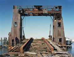 Ferry Gantry, North Brother Island  by Christopher Payne    North Brother Island is an island in the East River situated between the Bronx and Riker's Island