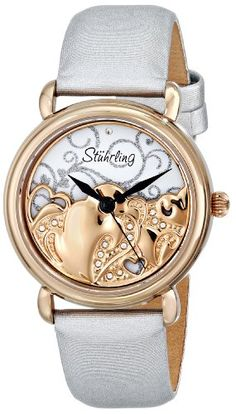Stuhrling Original Women's 709.04 Vogue Eros Analog Display Swiss Quartz White Watch. 16K rose gold layered round shaped case with polished beved bezel and onion shaped crown. Protective Krysterna crystal on front and decorated case back. Silver swirl design on matte finished dial with beaded Swarovski crystal design on rose tone spinning rotor and diamond at 12 o'clock position. White satin twill covered genuine leather strap with tang buckle. Water resistant to 165 feet (50 M): suitable…