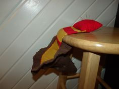 Sorting hat thread catcher and pin cushion