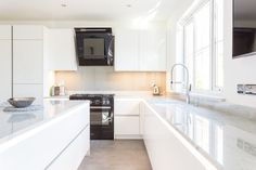 Handleless German Nolte Kitchen in Lux Gloss White with Matrix Art under counter lighting and a marble worktop. Gloss Kitchen Cabinets, White Gloss Kitchen, White Marble Kitchen, Custom Countertops, Bathroom Countertops, Custom Cabinets, Under Counter Lighting, German Kitchen, Bespoke Kitchens