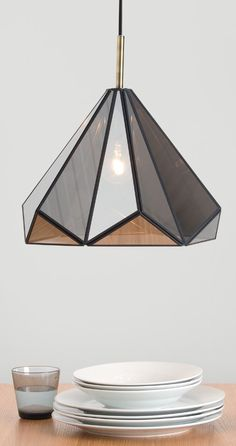 Eleanor pendant light, £79 MADE.COM It's faceted and reflective, like a precious gem. Crafted with 18 triangular pieces, all held together in a metal frame. The antique brass ceiling rose gives an on-trend finishing touch.