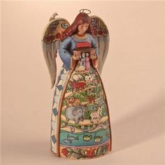 This Jim Shore Angel features a folk art scene on Noahs Ark on the skirt of the angel and is named 'Two by Two, God Loves All of You'. This highly intricate folk art collectible is hand-painted, and m