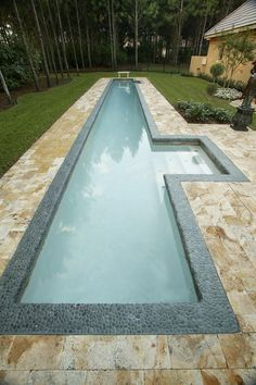 narrow pool with steps highlighted and clad with pebbles for a natural feel