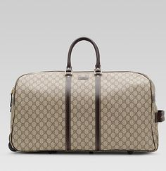 Gucci Duffel with wheels ... a girl can dream that she travels in style!