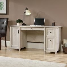 Introduce a touch of the contemporary to your workspace with this gorgeous chalked chestnut finished computer desk. There?s plenty of space to spread out, and when you?re done, tuck everything away thanks to abundant storage opportunities. Keeping things sleek and tidy, flip-down molding reveals a slide-out keyboard/mouse shelf, and a lower drawer that holds letter or European size hanging files. The storage area behind the door contains a vertical CPU tower with an adjustable shelf…