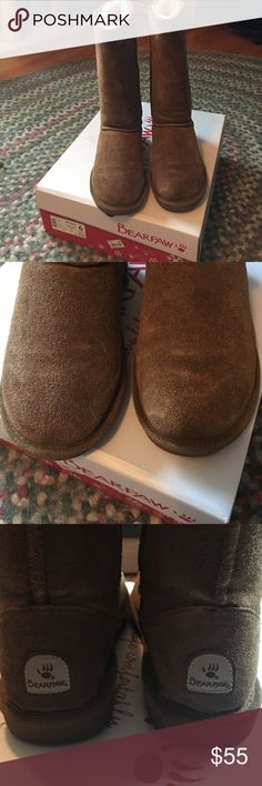 Tan tall bear paws Worn a handful of times, worn in the winter and in the rain, third picture provides water stain, but it's barely noticeable. Have all the tags inside the box. Selling because I don't like them anymore and they don't really fit. Size 6 BearPaw Shoes Ankle Boots & Booties