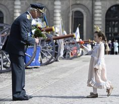 During the celebrations, the King was presented with a flower by a young girl dressed as a princess in the palace courtyard, pictured