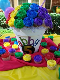 Rainbow cupcake bouquet. (Not really a cake...but awesome anyway!)