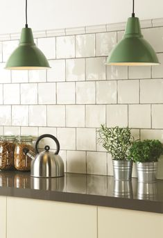 The classic white Porcelain field tiles is a timeless look. Coupled with the neutral, warm, earthy tone would suit a kitchen or bathroom area. Handmade ceramic tiles, made in the UK. winchestertiles.com