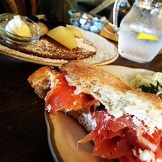 Salmon sandwich special....capers onions cream cheese and tomatoes! Lemon gingerbread pancakes with poached pears hiding in the background! #brunch #berkeley #lanote #lanoterestaurantprovencal #provencal #pancakes #salmon #creamcheese #capers #raspberrymimosa #mimosa #treatyoself #planetfat #fatkid #fatkids #fatkidprobs by planetfatlife