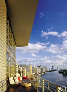 The corrugated-steel wall of a Miami Beach penthouse melds with the skyline beyond.