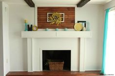 s why everyone is freaking out over these country cottage rooms, bedroom ideas, entertainment rec rooms, home decor, This repainted fireplace is so chic