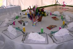 The most epic kids wedding table ever! Coloring placemats, bubbles, a candy centerpiece; the works!